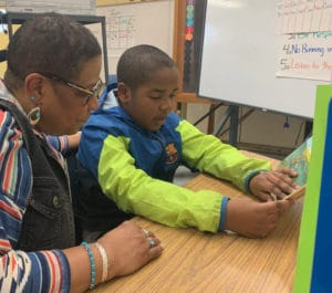 Jadon and volunteer reading tutor Linda Joseph during Succeeding by Reading session.