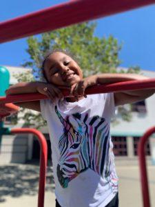 Aadae playing on playground