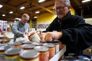 Volunteers pack thousands of bags of groceries.