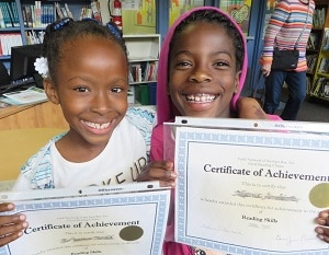 Two Succeeding by Reading students celebrate success.
