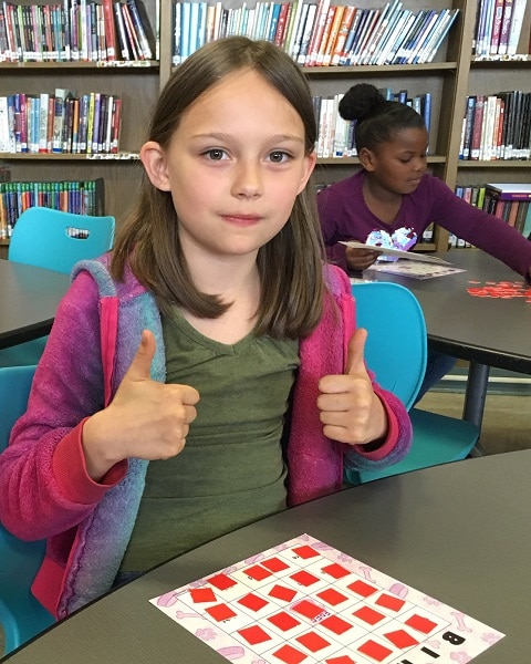 Julianna gives a thumbs up to learning math.