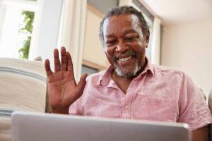 Man tutoring a child through online tutoring.